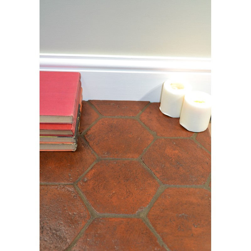 Hexagon shaped terracotta sealed in traditional manor.